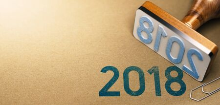 3D illustration of a rubber stamp with the year 2018 stamped on recycled paper background. Two Thousand Eighteen agenda concept.
