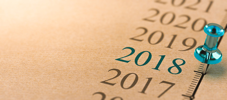 3D illustration of a timeline on kraft paper with focus on year 2018 and a blue thumbtack.