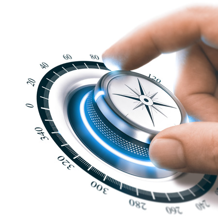 Hand turning a compass knob to the 360 degree position. Advertising or Marketing concept. Composite between a photography and a 3D background. Stock Photo