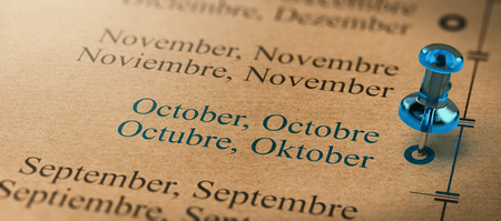 3D illustration of project or business planning with a thumb tack pointing on october. Months of the year concept.