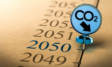 Special Pushpin with the text co2 pined on a timeline in front of the year 2050. Concept of climate plan and carbon dioxide reduction. Stock Photo