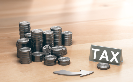 Piles of coins symbols on a wooden table and an arrow pointing a single coin with the word tax. Financial advisory and tax planning concept. 3d illustration.