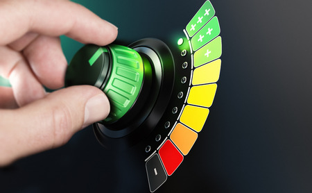 Hand turning a knob with efficiency scale from black and red to green color. Composite image between a hand photography and a 3D background.