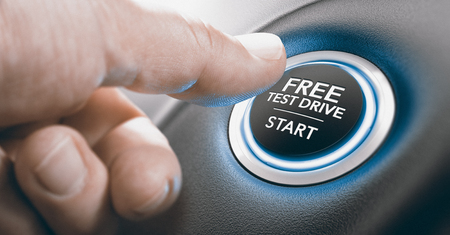 Man pushing a free test drive button. Composite image between a finger photography and a 3D background.
