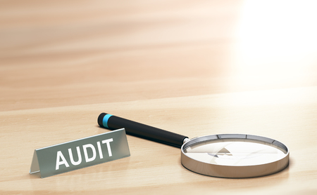 Magnifying glass and a sign with the word audit on a wooden table with copyspace at the background. 3d illustration