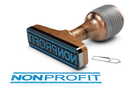 3D illustration of a rubber stamp over white background with the word nonprofit written in blue color Stock Photo