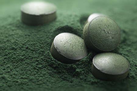Close up of Atisanal Spirulina Tablets on Powder Background With Low Depth of Field. Horizontal Image