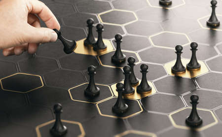 Conceptual board game with hexagonal shapes and a hand moving pawns. Black and golden background. Concept of market positioning or business strategy. Composite image between a hand photography and a 3D background.