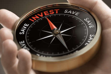 Hand holding a conceptual compass with the words invest or save. Investing strategy concept. Composite image between a hand photography and a 3D background.