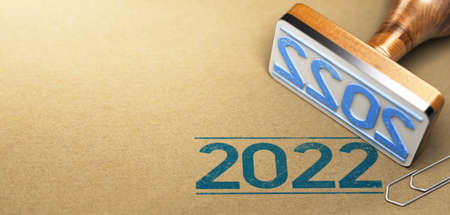 Rubber stamp with the year 2022 printed on a brown paper background with copyspace on the left side.
