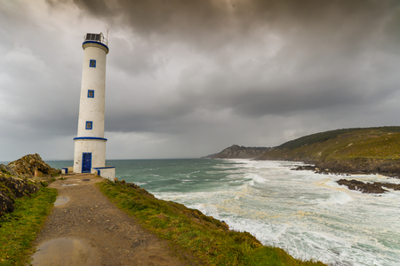 A small lighthouse at Cabo Home in Galicia - Spain Imagens