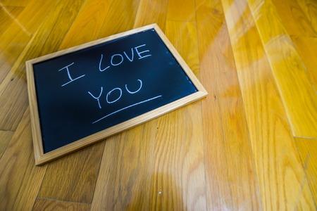 I love you written on a chalk board
