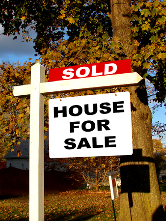 Sold Rider on real estate For Sale Sign Stock Photo - 1413476