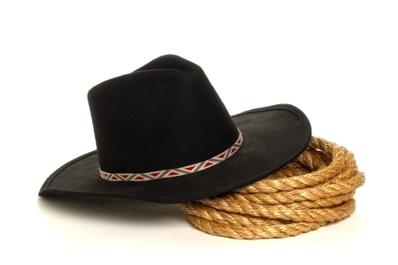 Black cowboy hat with rope over white background Stock Photo