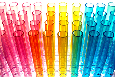 Multi color test tubes over white background