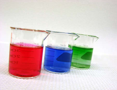 scientific glass cylinders filled with color liquids