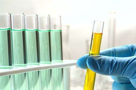 Scientist hand working with test tubes in a research lab Stock Photo - 1534231