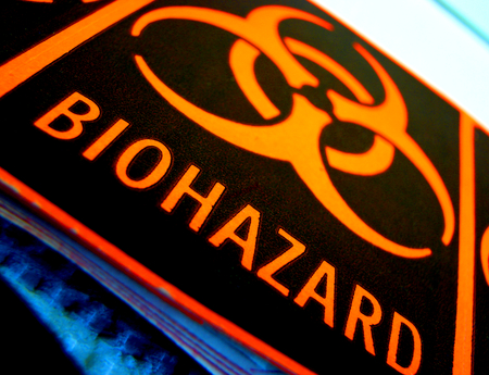 Biohazard label on equipment in a research lab Stock Photo - 1534187