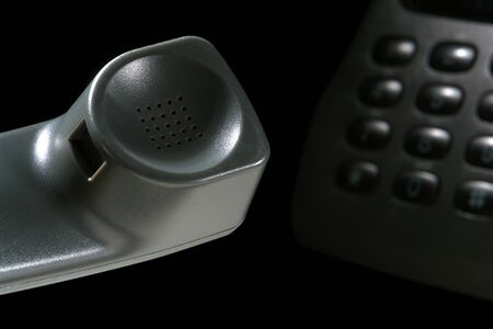 touchtone: Phone receiver and keypad on black background