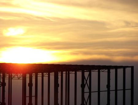 erection: Steel frame building under construction at sunset