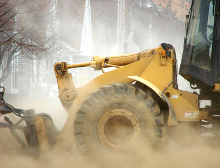 heavy industry: Heavy construction equipment creating a cloud of dust