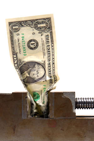 vise: One dollar bill crunched in a vise over white background Stock Photo