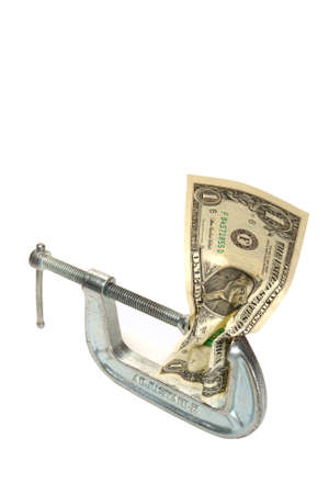 One dollar bill squeezed in a clamp isolated on white background photo
