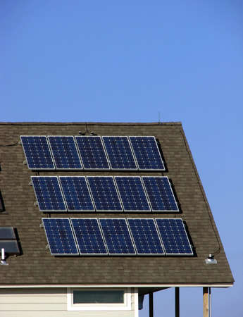 sufficient: Solar panel cells on a roof over blue sky Stock Photo