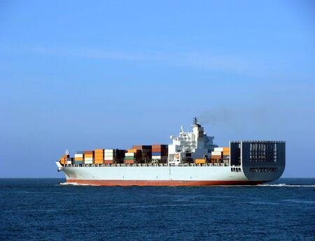 Container cargo ship sailing at sea