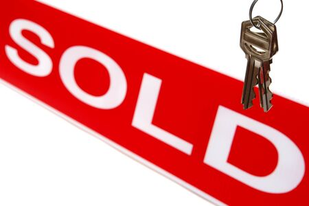 House keys and sold sign banner isolated on white Stock Photo - 1574042