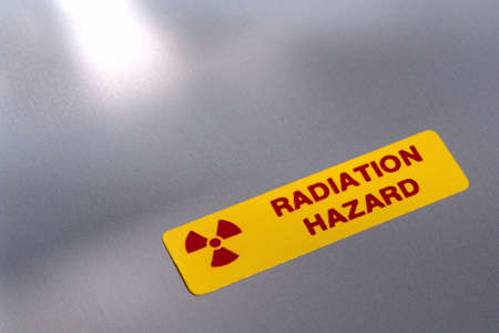 radiation hazard: Radiation hazard label on industrial equipment