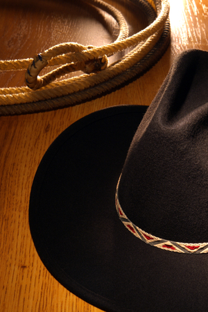 stetson: Black western cowboy hat and rodeo lasso