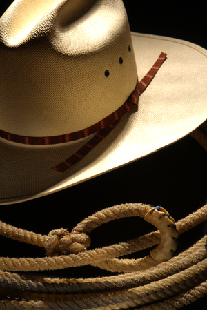 stetson: White cowboy hat and rodeo lasso