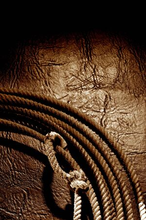 leather texture: Grunge rodeo lasso over leather background
