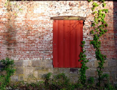 Door on a brick wall on an old industrial building