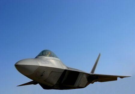 lockheed martin: F22 Raptor jet fighter over blue sky