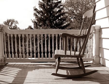 antique chair: Rocking chair on an old house porch