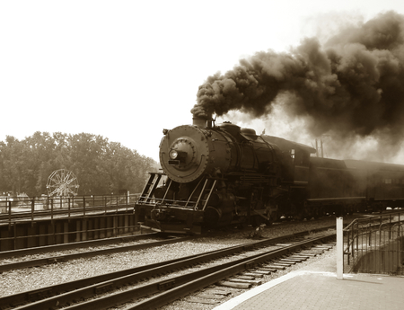 steam train: Vintage style steam engine with passenger car Stock Photo