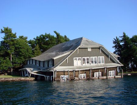 Sinking wood boat house on a river