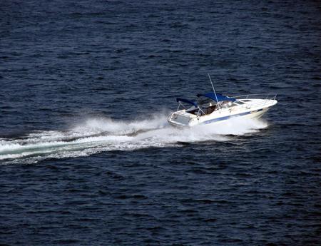 pleasure craft: Speeding motor boat