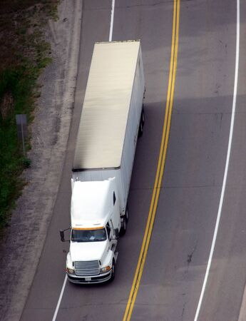 Tractor trailer on road viewed from above Stock Photo