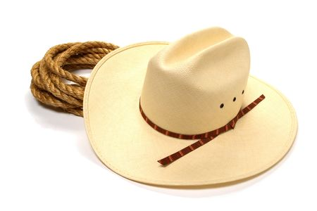 White western cowboy hat and rope over white background