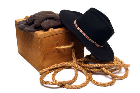 Black western cowboy hat over wooden box Stock Photo