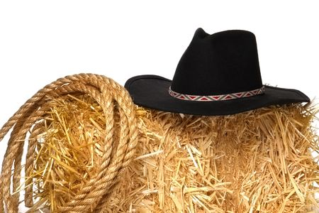 hondo: Black cowboy hat over bale of hay with rope Stock Photo