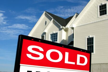Sold rider insert on a real estate sign in front of a house for sale Stock Photo - 1976954