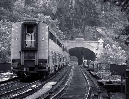 rear end: Rear of passenger train entering a tunnel