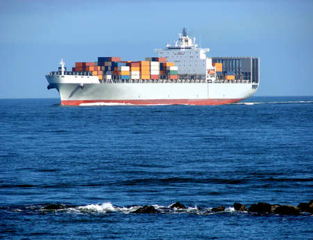 seafaring: Loaded container cargo ship sailing at sea