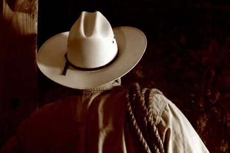 rodeo cowboy: Rodeo cowboy with white hat and rope on shoulder Stock Photo