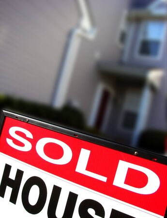 Red sold sign in front of a townhouse Stock Photo - 2226854