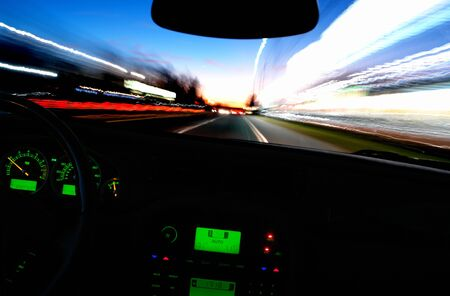 Blurry view of bright city lights through a moving car windshield Stock Photo - 2226861